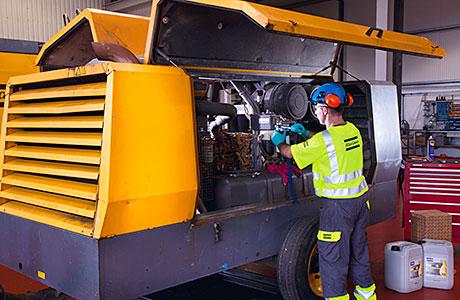 Atlas engineer working on compressor.