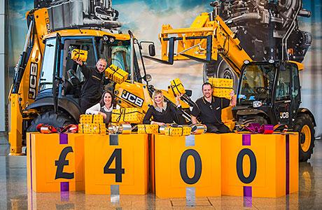 JCB's UK employees celebrated a £400 Christmas bonus.