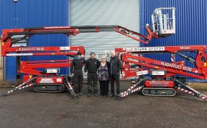 Jamie Palmer, Bryan Rogers, Margaret Ramsey and Leigh Baker, with two of the company's Hinowa tracked booms.