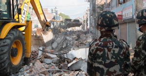 Earthmovers clear debris from the site of a building that collapsed in an earthquake in Kathmandu, Nepal, Tuesday, May 12, 2015. A major earthquake has hit Nepal near the Chinese border between the capital of Kathmandu and Mount Everest less than three weeks after the country was devastated by a quake. (AP Photo/Ranup Shrestha) ... Nepal Earthquake ... 12-05-2015 ... Kathmandu ... Nepal ... Photo credit should read: Ranup Shrestha/Unique Reference No. 22983026 ...