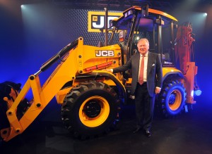 JCB Chairman Lord Bamford during the launch the 3CX Compact, a shrunk down version of one of the most famous JCB diggers as the company prepares to mark its 70th anniversary in just seven week's time. The launch is the result of a multi-million pound investment and the first machines have just started to roll off the production line. Photo/Rui Vieira