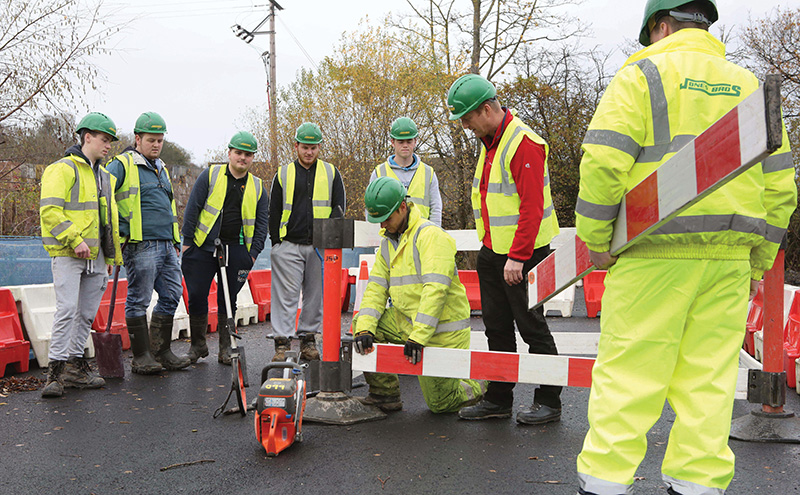 The latest intake of traineees at Jones Bros, Ruthin seen here in the company's new highways training area during their SQA induction with trainer Gwyn Davies, (red top)