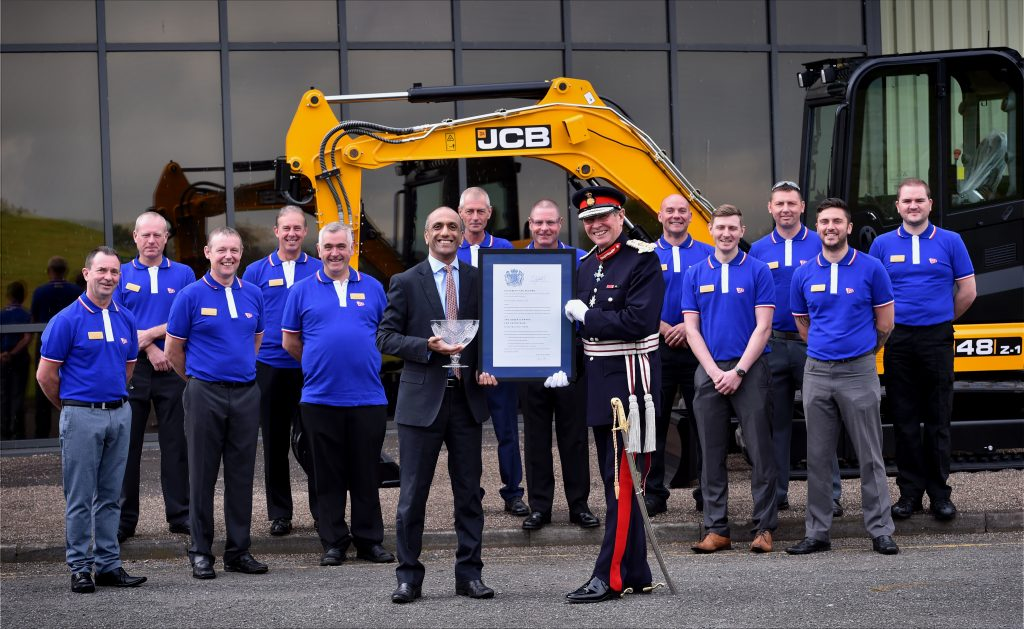 Pictured is left to right is Director of JCB Compact Products Buta Atwal receiving award from Lord Lieutenant Mr Ian Dudson CBE at JCB Compact Products, Cheadle Brief. Queen's Award presentation at JCB Compact Products Catagory.  Nws Date.   11.10.16. Time.   12pm